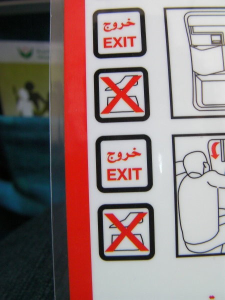 airplane safety sheet showing a red X through something indistinguishable