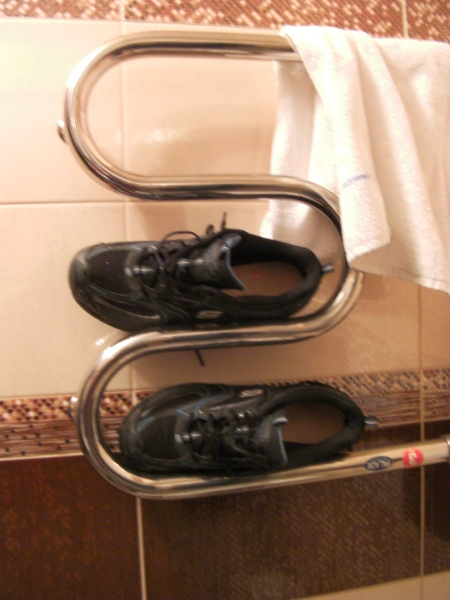 shoes placed on the heated towel rack