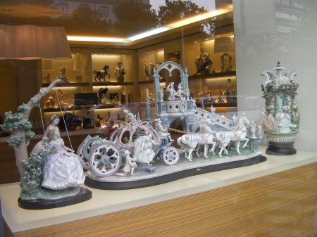 porcelain figures, a horse drawn carriage