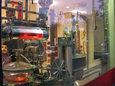 mechanical candy making machine in the store window
