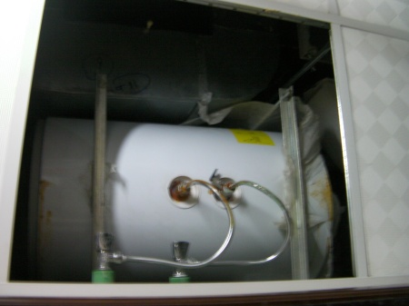 small water heater installed in ceiling space