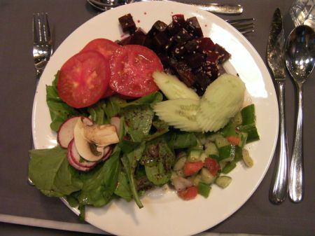 plate of tomatoes, cucumbers, beets, green salads