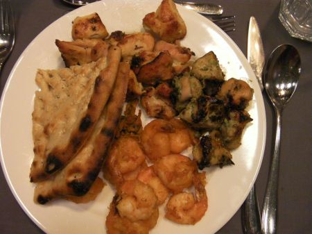 plate of chicken, shrimps, and bread