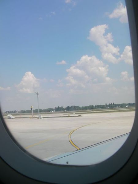 view out the airplane window at the runway