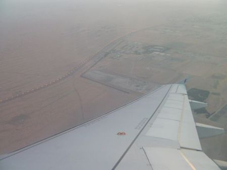 view of desert as plane is landing