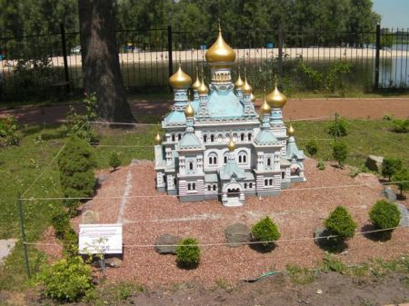 model of a blue church with golden domes