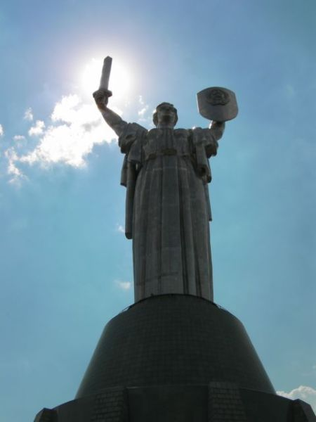 stainless steel statue of a woman holding a shield and a sword stands 62 meters tall