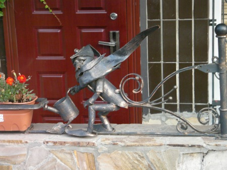 ironwork sculpture - bearded man with watering can