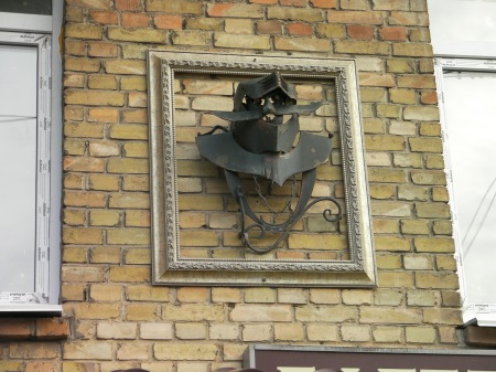 ironwork sculpture - knight's helmet mounted on the side of the building