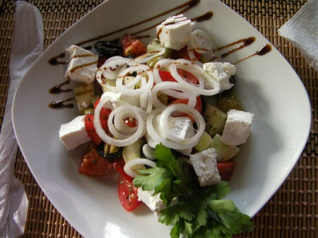 salad of cucumber, tomato, onion, feta cheese, and olives.