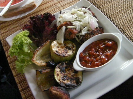 pork meat, grilled squash, and tomato sauce