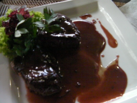 two pieces of beef steak with wine sauce