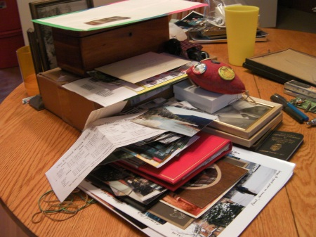 pile of photos and other keepsakes