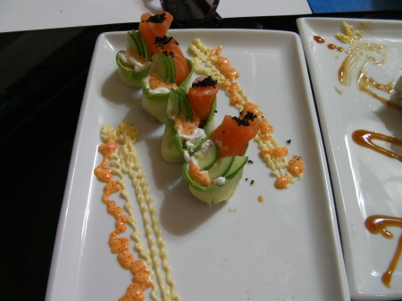 sushi roll of salmon and cucumber