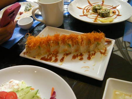 shrimp roll topped with fried carrot
