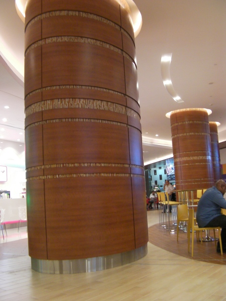 huge cement support column in a food court