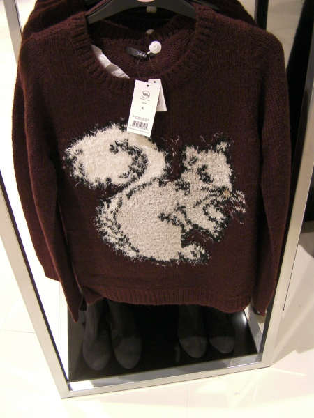 brown sweater with a cream colored squirrel on it