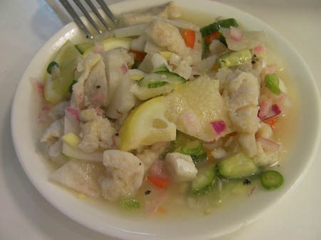 salad with fish, cucumbers, onions, lemon, turnip, and vinegar