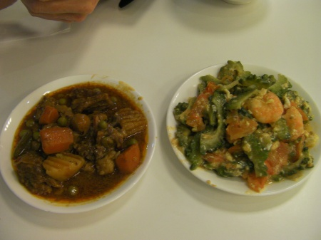 two plates, one with a beef dish and the other with a shrimp dish