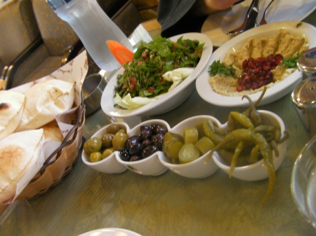 rocket salad, mutabel, bread, and olives