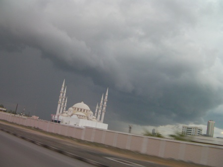 Mosque and dark grey clouds