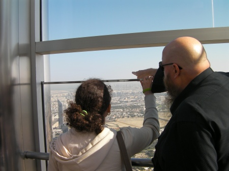 two people looking out from the observation deck