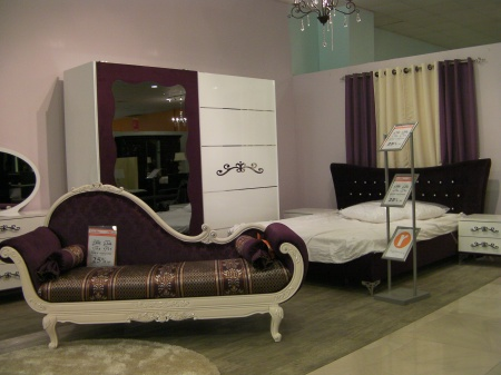 dark purple lounge chair and bedroom furniture