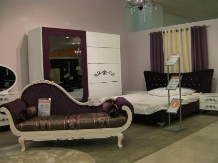 dark purple lounge chair and bedroom furniture