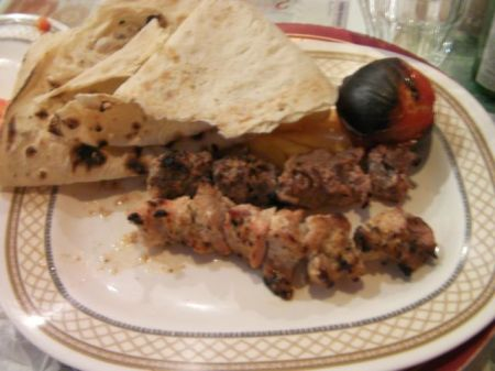 grilled chicken and beef with flat bread