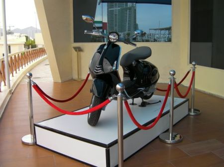 black vespa on display
