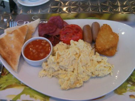 scrambled eggs, potato patties, link sausage, fried tomato, beans, toast, beef bacon