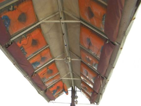 life preserver jackets attached to the underside of the boat roof