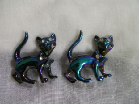 two blue cat brooches with rhinestone eyes