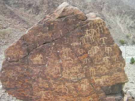large boulder covered with petroglyphs
