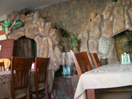 artificial rock-face waterfall inside the restaurant