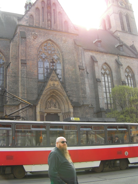 man in front of a tram in front of a church
