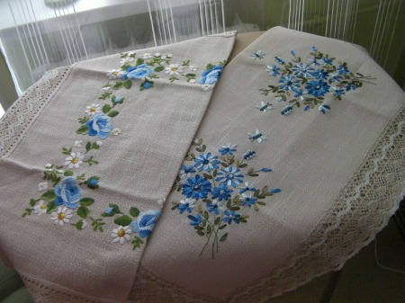 two table cloths embroidered with blue flowers