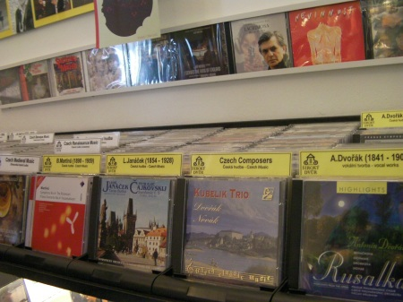 rows of compact discs in a music store