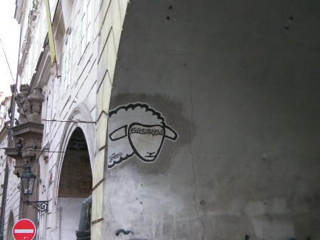 graffiti on an archway showing a sheep's head