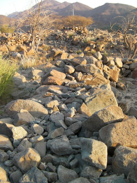 rock wall made of two rows of large stones with smaller stones filling the gap between