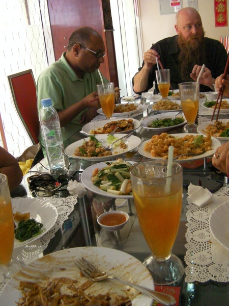 table filled with dishes of food