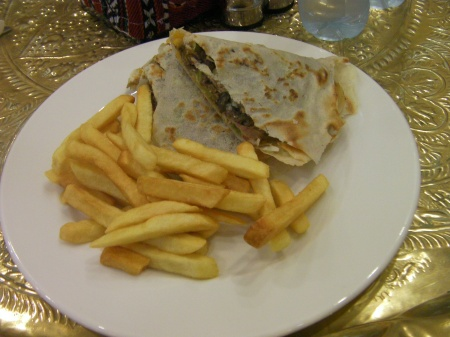 lamb in paper thin flat bread with fries