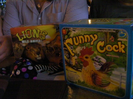 two boxed toys, lion and funny cock