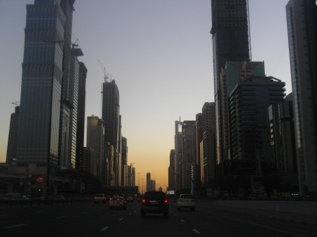 highway between two rows of skyscrapers