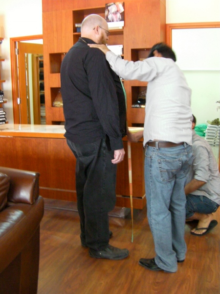 tailor measuring a customer