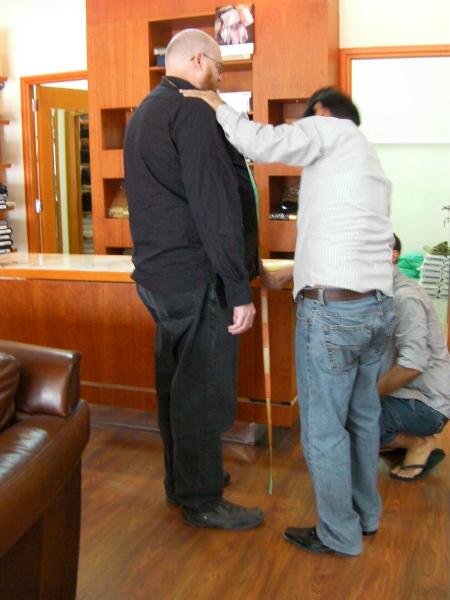 tailor measuring a customer