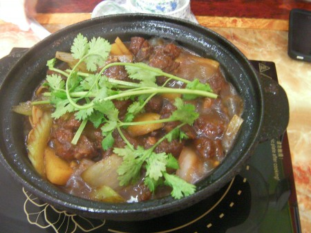 ceramic bowl of meat and potato stew