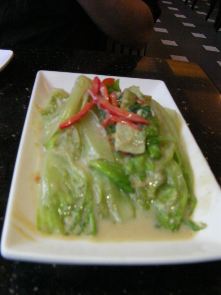 cooked lettuce in a sauce