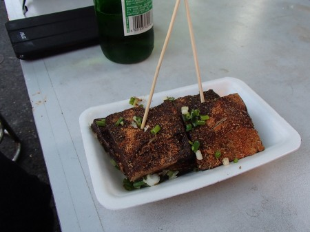 a plate of stinky tofu