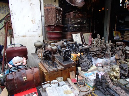 old sewing machines, statues, suitcases